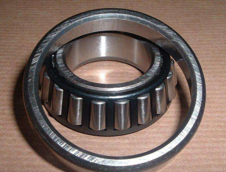 25 mm x 52 mm x 18 mm  NKE 22205-E-K-W33+H305 Spherical roller bearing